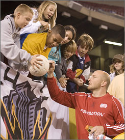 Revolution goalie Matt Reis signs autographs after the MLS team's first-round playoff match against New York last weekend.