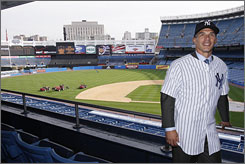 New Yankees manager Joe Girardi poses while wearing his jersey inside Yankee Stadium on Thursday after a press conference.