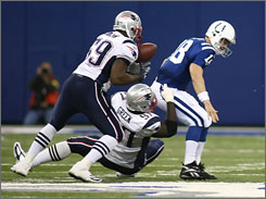 Rosevelt Colvin's recovery of a Peyton Manning fumble on the Colts' final drive was a key to New England's comeback.