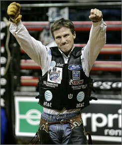 Justin McBride is happy after a ride Sunday that sealed another world title. He won the event in 2005, also teaming with the bull Camo.