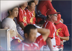 Jim Lefebrvre, wearing sunglasses, will manage the Chinese national team in the 2008 Olympics in Beijing.