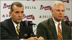 Frank Wren, right, was promoted to Braves' general manager after spending seven years in Atlanta's system as an assistant under former general manager John Schuerholz, left. The Braves have missed the playoffs the last two years.
