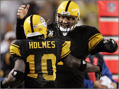 Pittsburgh quarterback Ben Roethlisberger celebrates a touchdown pass to receiver Santonio Holmes during the second quarter against Baltimore. Roethlisberger tied a Steelers single-game record with five TD passes in Pittsburgh's 38-7 win.