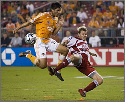 Houston's Brian Ching, left, scored a goal in the team's overtime playoff win against FC Dallas. Ching is one reason the Dynamo have been so successful in the clutch.