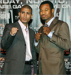 Miguel Cotto, left, and Shane Mosley pose during a news conference on Wednesday in New York. Mosley challenges for Cotto's WBA welterweight crown on Saturday night.