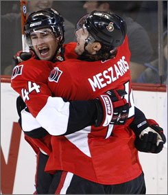 Ottawa's Patrick Eaves, left, celebrates his first-period goal with teammate Andrej Meszaros. The Senators are off to the best start in NHL history with a 13-1-0 record.