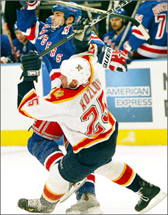 Eric Lindros and Victor Kozlov collide during a 2004 game between the New York Rangers and the Florida Panthers.