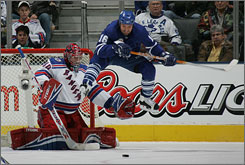 Darcy Tucker jumps to screen Rangers goaltender Steve Valiquette during their match at Toronto's Air Canada Centre.