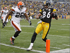Steelers receiver Hines Ward, right, led all players with seven catches for 80 yards and a touchdown in Pittsburgh's 31-28 win against Cleveland.