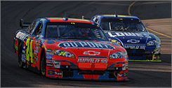 "Jeff Gordon, seen here leading teammate Jimmie Johnson during Sunday's race in Phoenix, wasn't too thrilled at how his Car of Tomorrow handled. ""This car is impossible to adjust once you get it off,"" Gordon said."