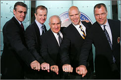 From left, Hockey Hall of Fame inductees Ron Francis, Al MacInnis, Jim Gregory, Mark Messier and Scott Stevens pose with their rings during their induction ceremony in Toronto.