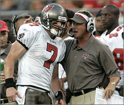 "Tampa Bay coach Jon Gruden, right, recruited quarterback Jeff Garcia as a free agent last offseason, three years after failing to sign the signal caller, who ""demanded"" the team acquire him, because of salary-cap restrictions."