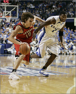 Thomas Sanders, left, and Gardner-Webb defeated a Kentucky squad that had three McDonald's All-Americans, including freshman Alex Legion. The Runnin' Bulldogs dropped the Wildcats by using backdoor cuts and beating them downcourt on transitions.