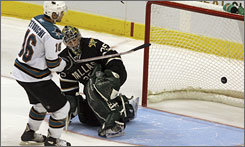 San Jose's Devin Setoguchi responded to being moved to the leadoff spot in the shootout lineup by beating Dallas goalie Marty Turco for a goal, helping the Sharks edge the Stars.