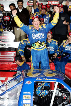 Ron Hornaday Jr. celebrates after capturing the NASCAR Truck Series championship at Homestead-Miami Speedway, becoming the eighth driver to win the title in eight years.