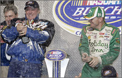Jeff Burton, right, breaks open the bubbly to celebrate with car owner Richard Childress after Saturday's 300-miler.