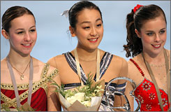 Japan's Mao Asada, center, came out on top at the Trophee Bompard on Sunday in Paris. Americans Kimmie Meissner, left, and 16-year-old Ashley Wagner finished second and third.