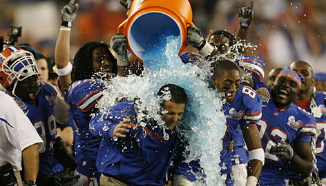 Florida coach Urban Meyer and receiver Dallas Baker enjoy a shower in the closing minutes of the BCS title game last January in Glendale, Ariz. The Gators beat Ohio State 42-14 to win the championship.