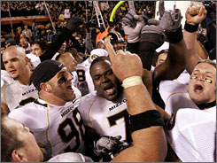 Missouri players celebrate after beating then-No. 2 Kansas 36-28 Saturday night. After starting the season unranked, the Tigers have climbed to No. 2 in the USA TODAY Coaches' Poll and No. 1 in the AP poll.