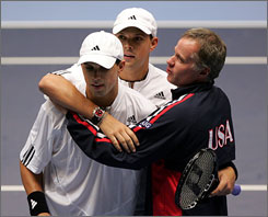 Patrick McEnroe, right, celebrates with Bob Bryan, center, and Mike Bryan after the U.S. doubles players defeated Sweden's Jonas Bjorkman and Simon Aspelin in three straight sets on Sept. 22. A victory over Russia would give the United States its first Davis Cup win since 1995.