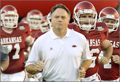 Arkansas coach Houston Nutt resigned three days after guiding the Razorbacks to an upset of No. 1 Louisiana State. Nutt went 75-48 since his hiring in December 1997.