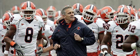 Ron Zook, center, brought Illinois back to relevance in college football, leading the Fighting Illini to a nine-win season that included an upset of then-No. 1 Ohio State.