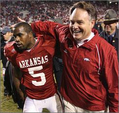 Houston Nutt, left, celebrates with running back Darren McFadden after Arkansas beat No. 1 LSU on Friday.