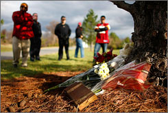 Fans congregated around a memorial to Sean Taylor outside Redskins headquarters Tuesday in Ashburn, Va.