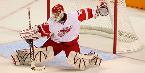 Chris Osgood is the top man in goal for the Detroit Red Wings for whom he leads the NHL with a 1.76 goals-against average.