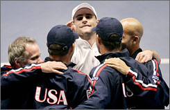 Andy Roddick, center, and the U.S. Davis Cup team celebrate its semifinal victory over Sweden in September.