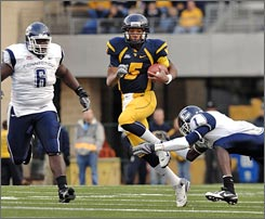 West Virginia, featuring running quarterback and Heisman hopeful Patrick White, can clinch a berth in the national championship game with a victory over Pittsburgh in the Backyard Brawl.