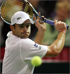 Andy Roddick, here returning a shot to opponent Dmitry Tursunov during the first Davis Cup final match, won his match to help the United States take a 2-0 lead in the best-of-five showdown with Russia.