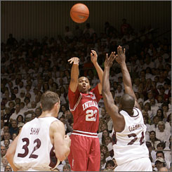 Indiana's Eric Gordon takes a shot over Southern Illinois' Matt Shaw (32) and Wesley Clemmons during Saturday's game in Carbondale.