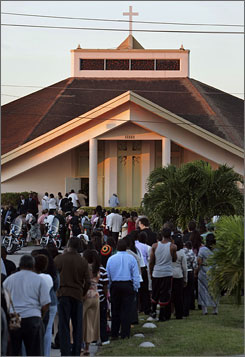 Mourners line up for the wake of Sean Taylor in Miami on Sunday.