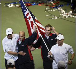 "From left, Davis Cup teammates Bob Bryan, James Blake, Andy Roddick and Mike Bryan helped bring the title back to the United States for the first time since 1995. ""We've been the ultimate team, and it's just been a blast and it's been an honor to be a part of that,"" said Roddick."