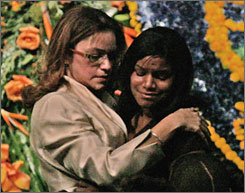 Taylor's younger sister Jazmin, right, is comforted after speaking at the funeral service on the Florida International University campus.