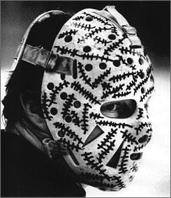 In 1968, Hall of Fame goaltender Gerry Cheevers became the first to decorate his mask. Boston trainer John Forristall added stitches to the mask after Cheevers took a shot to the face during practice, After that, the Bruins star added stitch marks every time a puck struck his mask.