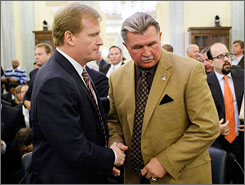 Mike Ditka, right, with NFL commissioner Roger Goodell, testified about benefits for retired players in September.