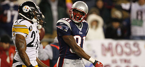 Patriots receiver Randy Moss jaws with Steelers defender Anthony Smith, who last week guaranteed Pittsburgh would deliver New England its first loss this season. Moss had seven catches for 135 yards and two touchdowns in the 34-13 win.