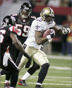 Marques Colston, seen here running past the Falcons' Lawyer Milloy and Michael Boley (59) in the first half, caught nine passes for 92 yards and two touchdowns to help the Saints keep their playoff hopes alive.