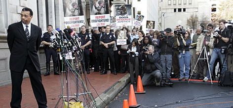 Michael Vick's attorney, Billy Martin, left, addresses the media after a judge sentenced the suspended quarterback to 23 months in prison on Monday morning. Protesters and animal-rights supporters appeared outside the courthouse during the sentencing.
