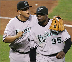 In the offseason's biggest trade to date, ex-Marlins Miguel Cabrera, left, and Dontrelle Willis left the National League to join yet another American League powerhouse, the Detroit Tigers.