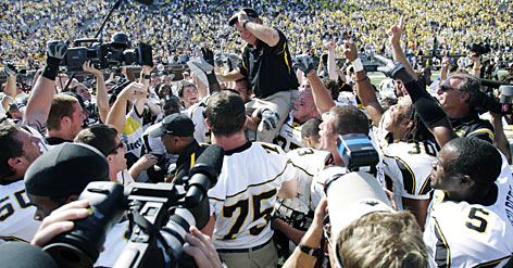Appalachian State players carry coach Jerry Moore off the field at Michigan Stadium after the Mountaineers shocked the Wolverines  and the rest of college football  with a 34-32 victory on Sept. 1. Despite the big win, the Mountaineers battled through injuries and two losses on the road back to the Football Championship Subdivision final.