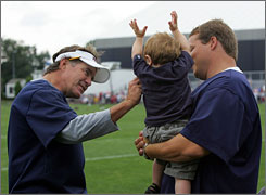 During happier times, Mangini, with his son during training camp in 2005, was Belichick's assistant in New England.