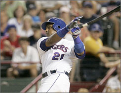Sammy Sosa cracks his 600th home run while with the Texas Rangers last season. The slugging outfielder is viewed as a winner after release of the Mitchell Report after getting just one mention in the study.