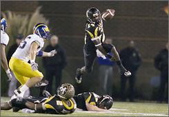 Appalachian State quarterback Armanti Edwards threw for three touchdowns and accounted for 287 yards of offense as the Mountaineers became the first team in the NCAA's Football Championship Subdivision to three-peat.