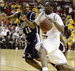Arizona State guard James Harden goes to the hoop against Xavier's B.J. Raymond.