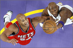 Nets forward Richard Jefferson, seen reaching for a rebound against the Lakers' Lamar Odom on Nov. 25, has risen to second place in scoring in the Eastern Conference.