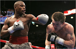 Floyd Mayweather Jr., left, beat Ricky Hatton in early December with a 10th-round knockout to improve to 39-0 with 25 KOs.