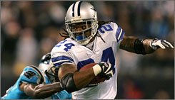 Dallas running back Marion Barber ran for 110 yards and scored a touchdown in the Cowboys' 20-13 victory against Carolina.